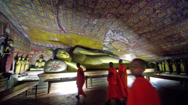 RECLINING BUDDHA AND YOUNG BUDDHIST MONKS