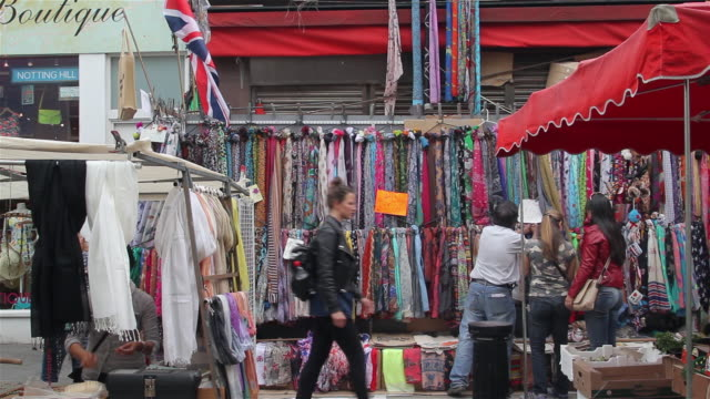 MARKET STALLS AND SHOPPERS