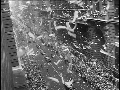 B/W 1945 high angle long shot ticker tape parade after World War II on New York City street
