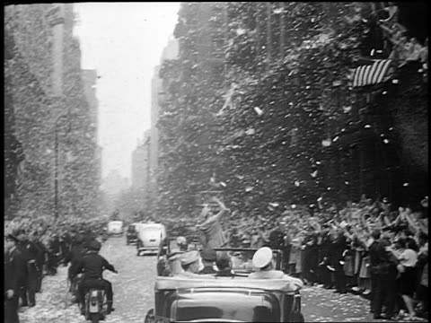 B/W 1945 car point of view behind General Dwight Eisenhower standing in car in ticker tape parade / NYC