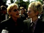 Ellen DeGeneres and Anne Heche talk to reporters on the red carpet at the 50th Annual Emmy Awards