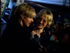 Ellen Degeneres and Anne Heche speak to a reporter on the red carpet
