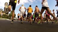 RUNNERS CHARGE OUT AFTER HORN SOUNDS ROAD RACE