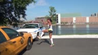 RUNNING FAST AN OBSTACLE RACER HURDLES OVER CARS WITHOUT SLOWING DOWN