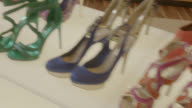 PAN LEFT TO RIGHT OF HIGH-HEELED SHOES ON DISPLAY. FASHION.