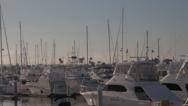 PAN RIGHT TO LEFT OF BOATS IN SAN DIEGO MARINA. DOCKS.