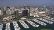AERIAL OF SAN DIEGO CITY SKYLINE. BOATS IN MARINA.