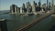 AERIAL OF BROOKLYN BRIDGE AND NEW YORK CITY SKYLINE.