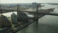 AERIAL OF QUEENSBORO BRIDGE. CITY SKYLINE VISIBLE.