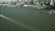 AERIAL OF NEW YORK CITY WATERFRONT. PIERS VISIBLE.