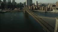 AERIAL OF BROOKLYN BRIDGE AND EAST RIVER.