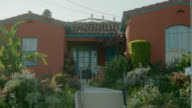 MEDIUM ANGLE OF SPANISH STYLE RANCH HOUSE.