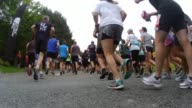 HUNDREDS OF RUNNERS START UP MOUNTAIN ROAD IN RACE FROM BEHIND