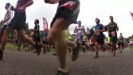 HUNDREDS OF RUNNERS START UP MOUNTAIN ROAD IN RACE FROM SIDE