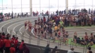 FEMALE RUNNERS ON INDOOR TRACK EARLY IN RACE LARGE PACK LONG SHOT