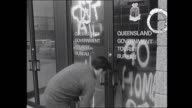 ANTISPRINGBOKS SLOGANS HAVE BEEN PAINTED ON THE DOORS OF THE QUEENSLAND TOURIST BUREAU PROTESTING THE QLD GOVERNMENT GRANTING LEAVE FOR THE SOUTH...