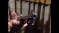 CLOSE UP GUN HELD / CU VARIOUS SHOT PUMP ACTION SLIDER OF GUN MOVED / CU FINGER ON TRIGGER AND PULLED / PUMP RELOAD ACTION SLID AND TRIGGER PULLED /...