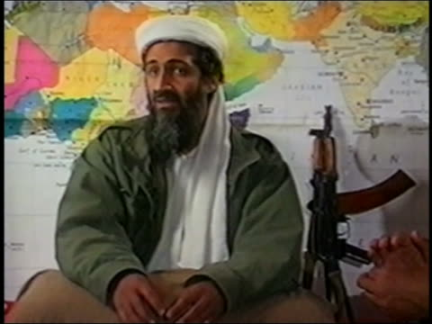 Osama bin Laden talking in front of map of Africa and South Asia / rifle in background / AUDIO