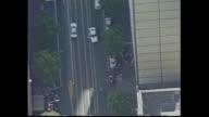 QUEEN STREET FILE AERIAL POLICE CARS ON STREET – BLURRED GUNMAN VITKOVIC'S BODY ON PAVEMENT ONLOOKERS ON STREET –/ BROKEN WINDOW / EXT BUILDING SOG...