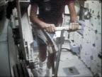 1983 medium shot tilt up astronaut Sally Ride running on treadmill aboard Space Shuttle Challenger