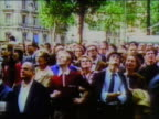 1969 wide shot crowd of people on street watching first moon landing