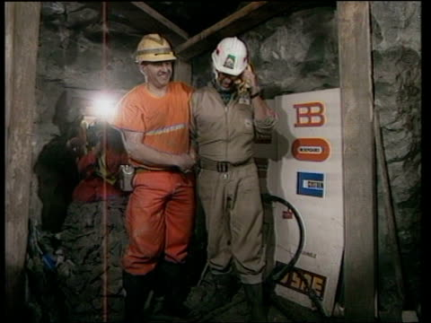 January 12 1990 FILM MONTAGE Heads of English and French construction teams posing with arms around each other shortly after meeting through a hole...