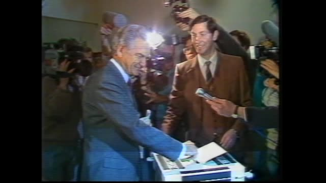 PRIME MINISTER BOB HAWKE WITH VOTER TELLING HOW TO VOTE PATS ON BACK / HAWKE CASTING HIS VOTE / HAWKE AND HAZEL WALK HAWKE WITH BABY / BOB AND HAZEL...