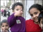 Prewar Iraq / WS MS Street scenes of Iraqi children / Iraq