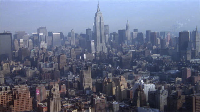 AERIAL OF EMPIRE STATE BUILDING AND MANHATTAN.