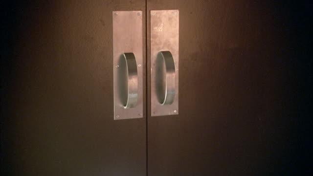 MEDIUM ANGLE DOUBLE DOORS WITH STEEL HANDLES.