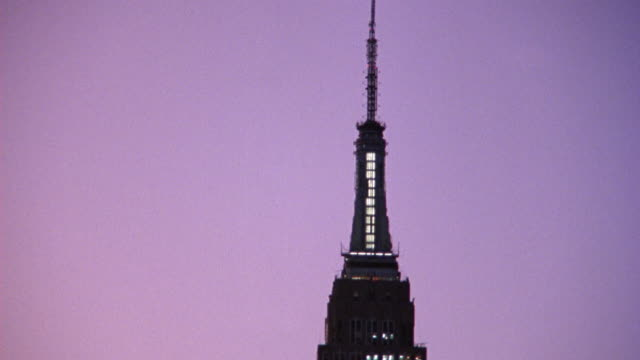 AERIAL OF TOP OF EMPIRE STATE BUILDING AND SPIRE.