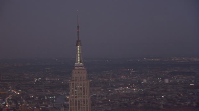 AERIAL OF TOP OF EMPIRE STATE BUILDING WITH SPIRE. CIRCLES TO RIGHT.