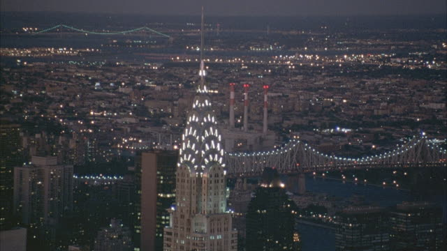 AERIAL OF CHRYSLER BUILDING WITH QUEENSBORO BRIDGE IN BACKGROUND.