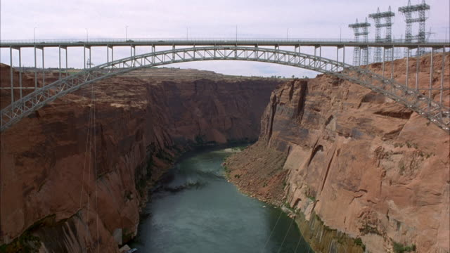 EST WIDE ANGLE ON BRIDGE ACROSS GLEN CANYON WITH COLORADA RIVER RUNNING BELOW.