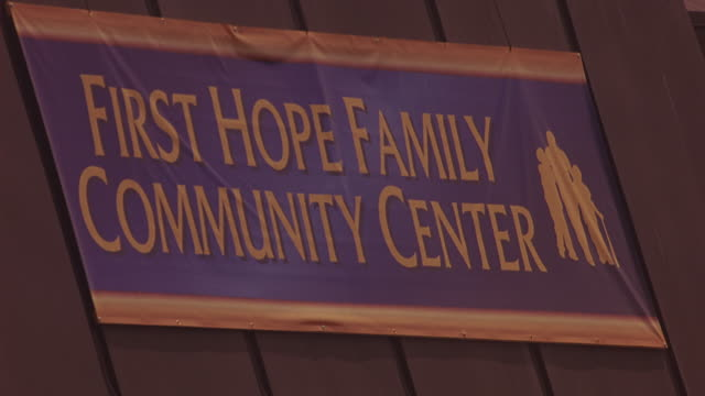 WIDE ANGLE OF SIGN ON ROOFTOP THAT READS FIRST HOPE FAMILY COMMUNITY CENTER. CHURCH OR COMMUNITY CENTER.