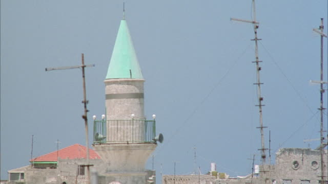 MEDIUM ANGLE PAN LEFT OF SPIRES IN TOWN IN MIDDLE EASTERN COUNTRY. MIDDLE EAST.