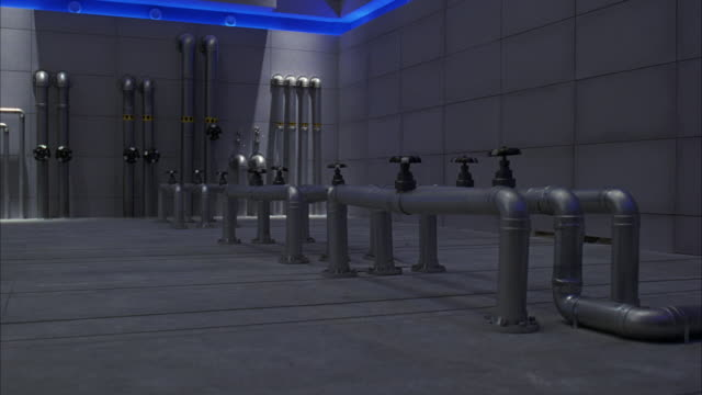 MEDIUM ANGLE OF METAL PIPES RISING FROM CONCRETE FLOOR OF LARGE BUILDING OR LABORATORY. SEE VALVES ON TOP OF PIPES. SEE BLUE GLOW FROM LIGHTS IN CEILING. FUTURISTIC.