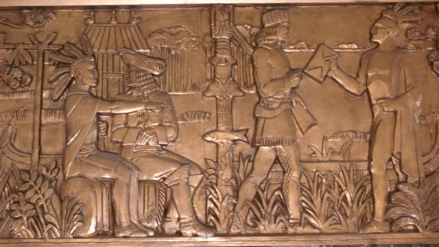 PAN LEFT TO RIGHT OF LOUISIANA HISTORY AND LIFE A FRIEZE AT THE LOUISIANA STATE CAPITOL BUILDING IN BATON ROUGE.  THE SCENE DEPICTS THE BURIAL OF SPANISH EXPLORER HERNANDO DE SOTO IN THE MISSISSIPPI RIVER,
