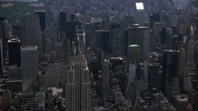 AERIAL. MEDIUM SHOT OF MIDTOWN MANHATTAN. SEE EMPIRE STATE BUILDING, METLIFE OR PAN AM BUILDING AND CHRYSLER BUILDING. HIGH RISES.