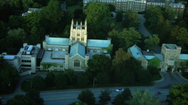 AERIAL OVER VASSAR COLLEGE. COULD BE USED FOR  IVY LEAGUE SCHOOL, UNIVERSITY COLLEGE CAMPUSES. LOW LEVEL FLIGHT OVER TREES, GOTHIC STYLE LIBRARY BUILDING