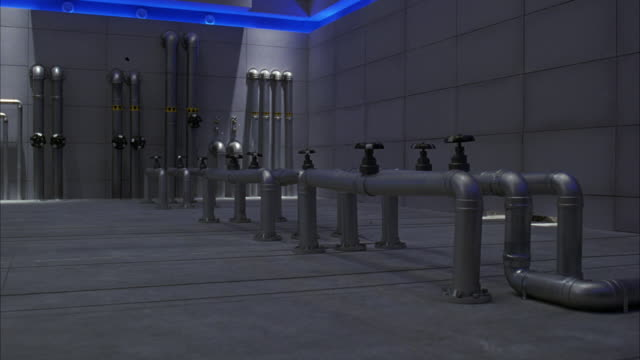WIDE ANGLE OF METAL PIPES CONNECTED TO CONCRETE FLOOR OF LABORATORY OR LARGE BUILDING. SEE VALVES ON TOP OF PIPES. SEE BLUE GLOW FROM NEON OR OTHER LIGHTS CEILING. LARGE BLACK GLOBES OR MACHINES CRASH THROUGH THE WALL, DESTROYING THE PIPES.