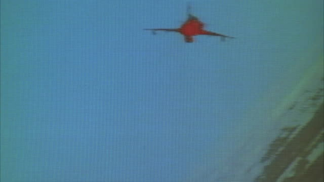 TRACKING SHOT OF KFIR JET FLYING OVER DESERT AWAY FROM CAMERA IN BANKED RIGHT TURN. INFRARED. MIDDLE EAST.