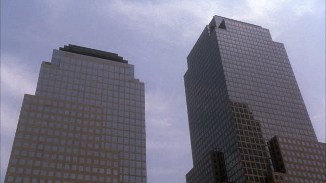 UP ANGLE ON TWO COMMERCIAL HIGH RISE OFFICE BUILDINGS, THE WORLD FINANCIAL CENTER IN LOWER MANHATTAN.