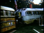 Graffiticovered buses and man sitting at drum kit in field at Woodstock music festival/ Bethel New York USA