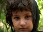 September 15 2005 CU Portrait of girl looking at camera / Peshawar Pakistan / AUDIO
