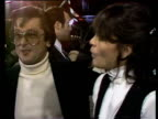 1980s MONTAGE Celebrities on red carpet including Ali MacGraw Hugh Hefner Robert Evans Barbi Benton Sondra Theodore and George Gradow / Los Angeles...