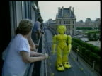 9Jun1998 MONTAGE Parade through city streets with giant figures / Paris France / AUDIO