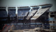 March 16 2010 WS SLO MO Three excavators pulling down portion of the upper deck of the old Yankee Stadium / Bronx New York City