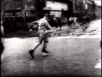 German Luftwaffe fighter pilots running out of building and towards planes as sirens sound in warning / Germany