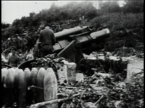 British Army unit operating artillery weapon pivoting it up and firing / Flanders Belgium